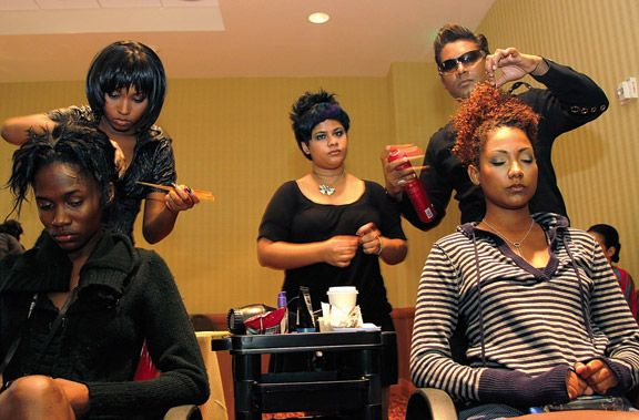 Hairstylist Ashvin Bally (right) and his team. Photograph by Sean Drakes