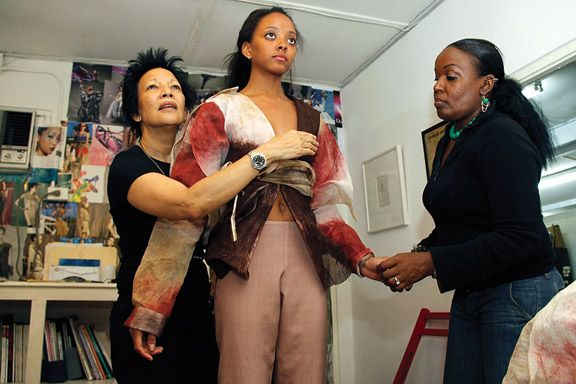 Designer Meiling (left) and Marcia Llanos fit Michelene Auguste. Photograph by Sean Drakes