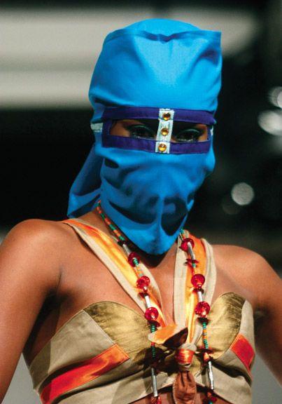 A masked model from Simply Garnett, Garnett D'Andrade's fashion label. Photograph Edison Boodoosingh