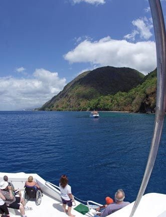 Cruising along Dominica's west coast, where whales can be seen all year round. Photograph by Paul Crask