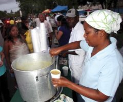 A regular sight on the eastern side of the Queen`s Park Savannah, Trinidad, a corn soup vendor serves her many customers. Photograph by Shirley Bahadur