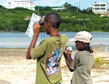 Two youngsters enjoy learning to identify birds at East End Salt Pond, Anguilla, during a SCSCB wetlands education workshop. Photograph courtesy Birdlife International/Lisa Sorenson