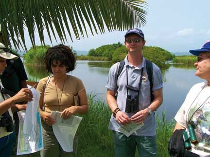 Birdlife's David Wege with Laura Perdomo and Yvonne Arias of Grupo Jaragua, at work in the wetlands of the Dominican Republic. Photograph courtesy Birdlife International