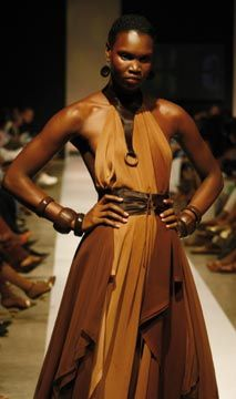 Faded chiffon layered dress with pony skin belt and collar accents. Photograph courtesy Pulse Investments Ltd