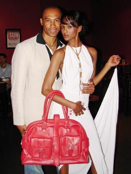 Ken Williams and Miss World Canada pose with one of his bags. Photograph courtesy Roger Edralin