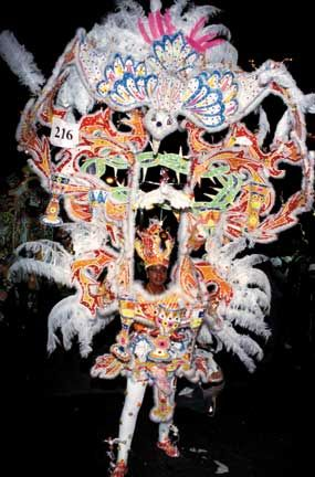 Junkanoo costumes are traditionally made from strips of crêpe paper and cardboard, nowadays ornamented with rhinestones, glitter. Photograph courtesy the Bahamas Ministry of Tourism