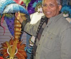 Anton Gabriel with some of his carnival memorabilia. Photograph by Donna Yawching