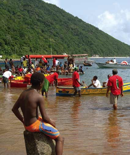Traditional Carib canoe racing at the village of Soufriere. Photograph by Celia Sorhaindo