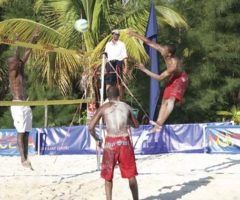 Gregory Gill of Barbados watches his partner Elwyn Oxley spike as Philippe Pignol of Guadeloupe attempts to block in the final. Photograph courtesy Leisure Entertainment