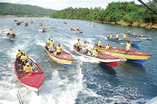 Local fisherfolk heading out for the canoe tournament. Photograph courtesy Port Antonio International Marlin Tournament