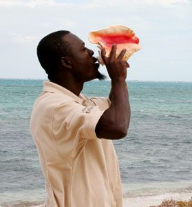 Conch Blower: The soulful wail of the conch is one of the sounds of the annual TCI Conch Festival. Photograph courtesy TCI Conch Festival/Debbie Mohnssen