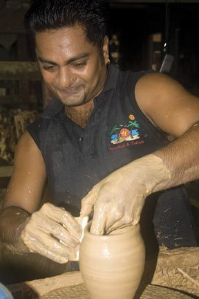 Shiva Ragoonanan hard at work at his potter's wheel, forming an urn used in Hindu pujas. Photograph by Mirissa De Four