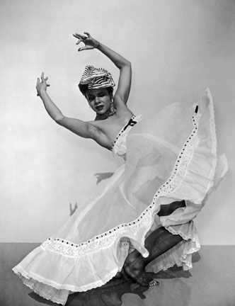American dancer and choreographer Katherine Dunham in an Afro-Caribbean-inspired dance. Photograph by Hulton Archive/Getty Images