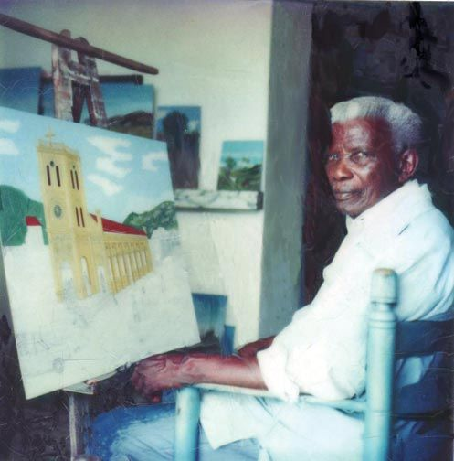 Philomé Obin in his studio in 1983. Photo used under Creative Commons License from Wikipedia.com