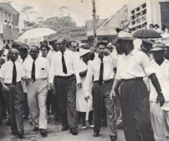 The 1960 march in the rain to demand the return of Chaguaramas to the people of Trinidad and Tobago. Front row, from left: government ministers WJ Alexander, Dr Eric Williams, Learie Constantine, Dr Patrick Solomon and Ulric Lee. Photograph by Sampson Studios, courtesy Kim Johnson