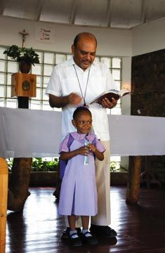 Fr Ramkissoon with one of the Mustard Seed Children. Photograph by Varun Baker