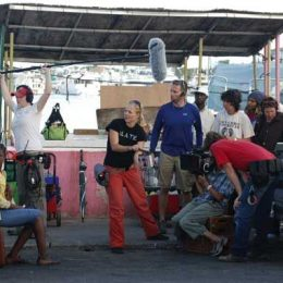 Maria Govan (right, in white) behind the scenes directing her award-winning film. Photograph courtesy Maria Govan