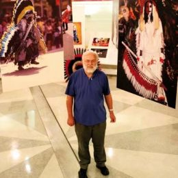 Ray Funk at the National Library of Trinidad and Tobago, surrounded by examples of traditional wild Indian mas. Photograph by Andrea De Silva