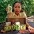 A local girl shows off some of the organic products produced in the region. Photograph by Ian Brierly