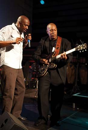 Kenny Phillips accompanies well-known soca artiste, Iwer George. Photograph courtesy Kenny Phillips
