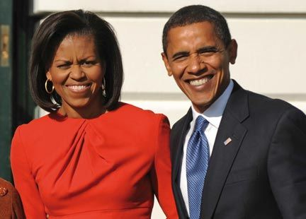 President Barack Obama and his wife Michelle stand outside the White House on November 10, 2008. Photograph by TIM SLOAN/AFP/Getty Images