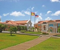 The Grenadian and US flags fly in front of the Windref Research Institute. Photograph courtesy SGU