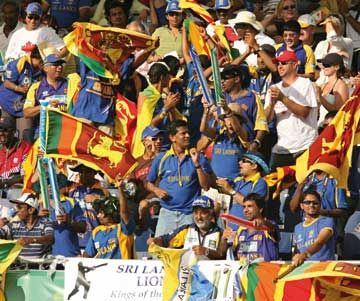 Sri Lankan cricket fans cheer for their team as they challenge Australia during the final of the ICC Cricket World Cup 2007. Photograph by Greg Wood/AFP/Getty Images