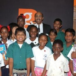 Get Caught Reading series co-editor and author Nasser Khan with beaming schoolchildren who took part in the launch. Photograph by Petronella Griffith