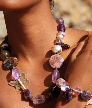 A model wears a bracelet and necklace of amethyst, fluorite, Swarovski crystal and sterling silver. Photograph courtesy Calvin French
