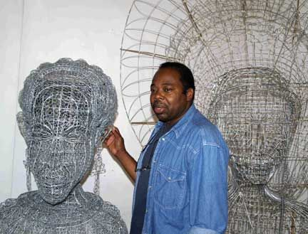Gabriel with some of his creations. Photograph by David Katz