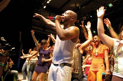With excited fans around him, Wyclef Jean belts out one of his hits at Festival Village, St Maarten. Photograph by Judy Fitzpatrick