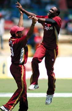 West Indies players Dwayne Bravo and Ramnaresh Sarwan in a moment of cricket ecstasy. Photograph by Robert Taylor
