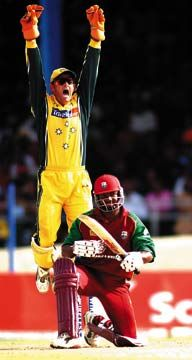 Australian wicket keeper Adam Gilchrist celebrates the dismissal of West Indies captain Brian Lara. Photograph by Robert Taylor