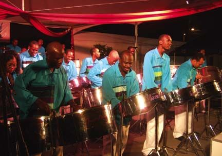 Players from Caribbean Airlines Invaders Steel Orchestra perform at Pan, Parang and Pork. Photograph courtesy Invaders Steel Orchestra