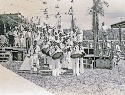 "Desperadoes coming off the Savannah stage, Carnival 1951, playing ""Cranes"" fancy sailor. Photograph by Jack Williams"