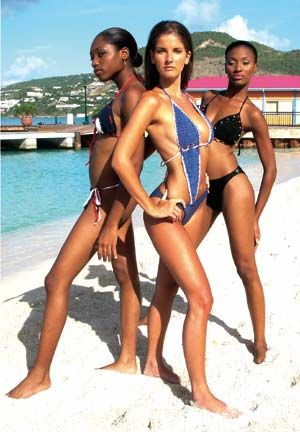 Models Kimberly Meyers (left), Nicola (centre) and Charity Dunker are ready to conquer the waves in these crochet swimwear piece. Photograph by Bevil Byam