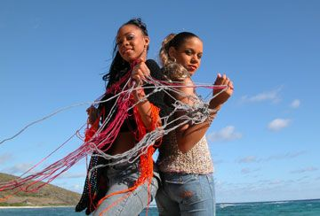 Spinning yarn into gold? Davina (left) and Bianca in a poncho and multi-coloured sleeveless top. Photograph by Bevil Byam