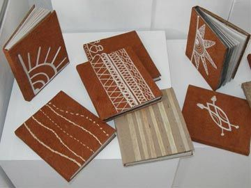 Handmade paper journals covered with embroidered bark cloth, handmade paper, and raffia. Photograph courtesy Lesley Ann Noel