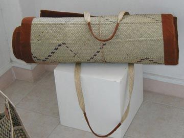 Beach mat made of woven straw with bark cloth trim. Photograph courtesy Lesley Ann Noel