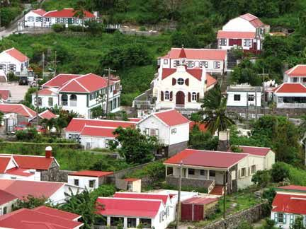 Traditional Saban cottages — and modern cottages decorated in traditional colours — in the village of Windwardside. Photograph by Nicholas Laughlin