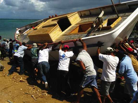 Launching a traditional Carriacou sloop at Windward. Photograph by Paul Crask