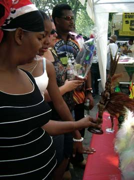 Shopping for Carnival souvenirs along the Parkway. Photograph by Erline Andrews