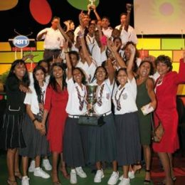 Young Leaders and teachers of Waterloo High School celebrate their victory with Catherine Kumar, Managing Director, RBTT Bank. Photograph courtesy RBTT Financial Group