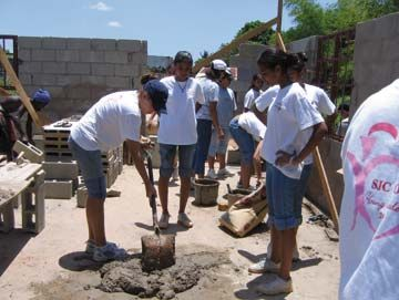 The Young Leaders group from St Joseph's Convent, Port of Spain, at work on the Rambarans' new home. Photograph courtesy St Joseph's Convent, Port of Spain