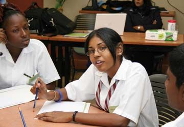 Takyanna Nedd of Roxborough Composite School and Brillience Sammy of Waterloo High School discuss ideas. Photograph courtesy RBTT Financial Group