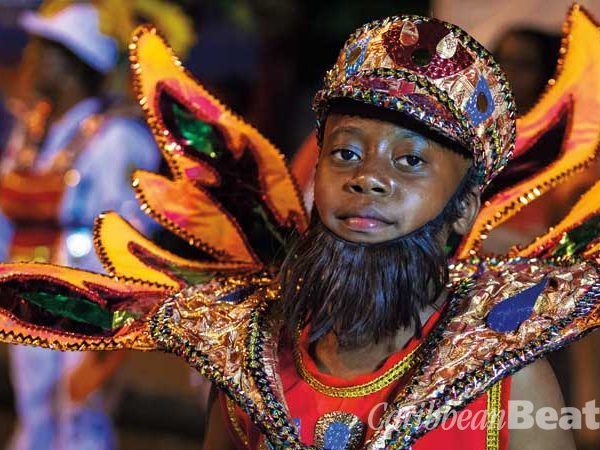 A young masquerader portrays a Fireman, a version of traditional sailor mas. Photograph by Maria Nunes