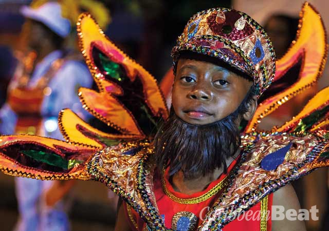 A young masquerader portrays a Fireman, a version of traditional sailor mas. Photograph by Maria Nunes