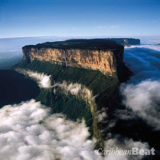 Rising sheer from the great savanna of the Guyana Shield, Roraima — a flat-topped tepui, whose unearthly topography inspired Arthur Conan Doyle's novel The Lost World — boasts the Triple Point where the borders of three nations meet. © Adrian Warren/www.lastrefuge.co.uk