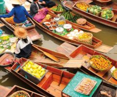At one of Bangkok's floating markets, vendors offer a dizzying array of vegetables and fruit. Photograph by Nimon/Shutterstock.com