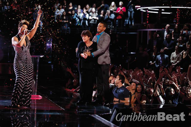 Chin's mother and husband join her on The Voice stage, after she was named winner of the contest. NBCU Photo Bank Via Getty Images
